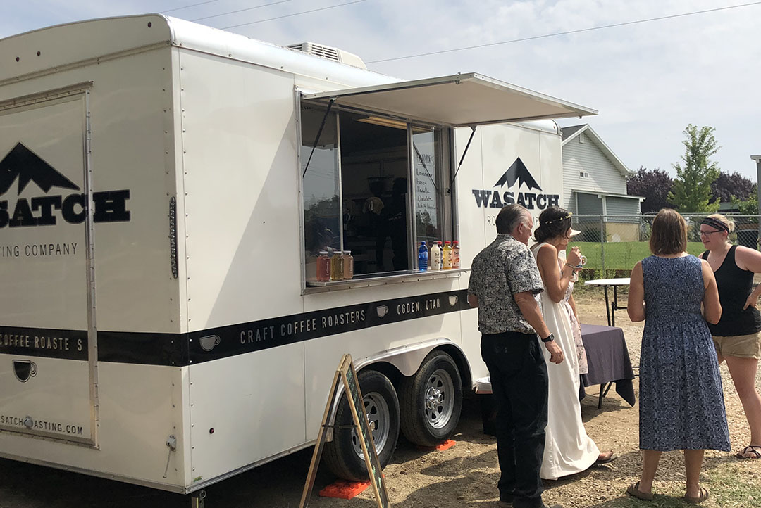 A photo of the Wasatch Roasting trailer at an event